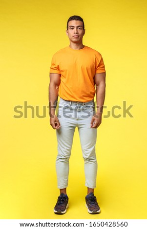 Full-length vertical shot masculine hipster guy, hispanic ethnicity, standing casually yellow backgr Stock photo © benzoix
