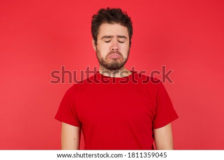 Upset, gloomy and depressed young hispanic man in t-shirt, frowning sighing sad, pointing and lookin Stock photo © benzoix