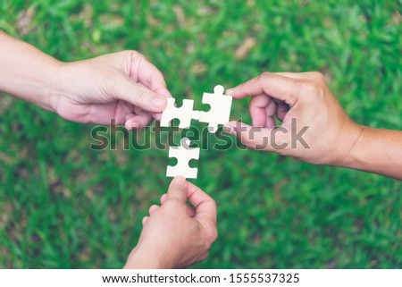 Icon of three persons and puzzle for problem solving or crisis management team concept Stock photo © ussr