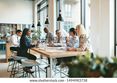 Businesspeople or lawyer having team meeting discussing agreemen Stock photo © Freedomz