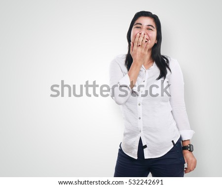 Photo of pretty excited woman covering her face and looking at camera Stock photo © deandrobot