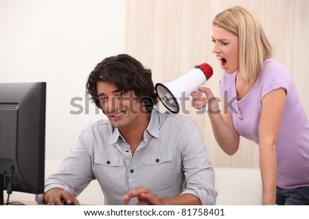 a man doing computer and a woman yelling on him with a megaphone Stock photo © photography33