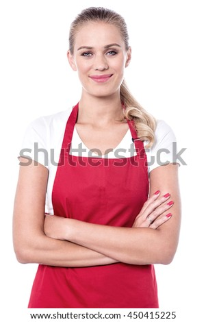 Smiling young woman with crossed arms wearing apron and rubber gloves Stock photo © wavebreak_media