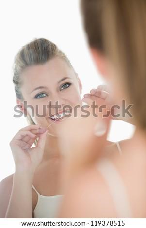Bonitinho mulher fio dental espelho branco mão Foto stock © wavebreak_media