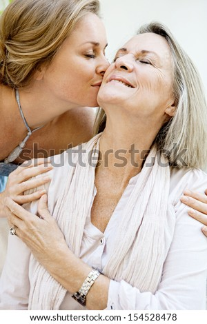 Close-up portrait of woman being affectionately kissed by her hu Stock photo © dacasdo