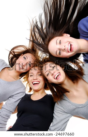Group of happy women standing in huddle, smiling, low ange view. Stock photo © dacasdo