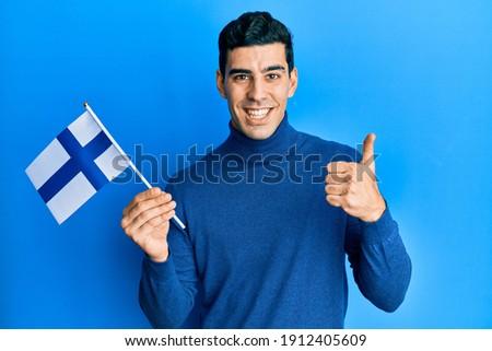 Finlândia bandeira polegar para cima gesto excelência Foto stock © vepar5