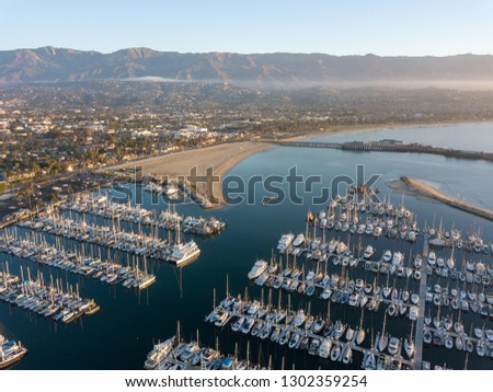 Santa Barbara Harbor with Yachts Boats at Sunrise in Silhouette Stock photo © cmcderm1