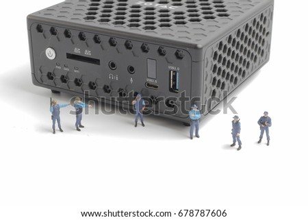 miniature police squad protecting laptop computer technology concept stock photo © kirill_m