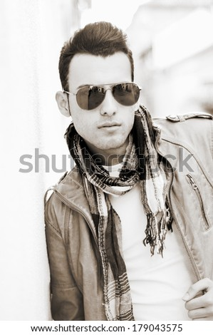 Jól kinéző férfi napszemüveg visel kabát sál Stock fotó © feelphotoart