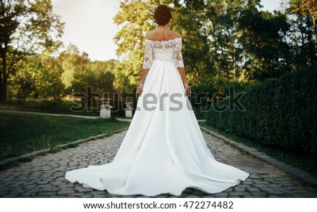 Beauty Fashion young bride model posing in wedding dress with ha Stock photo © Victoria_Andreas