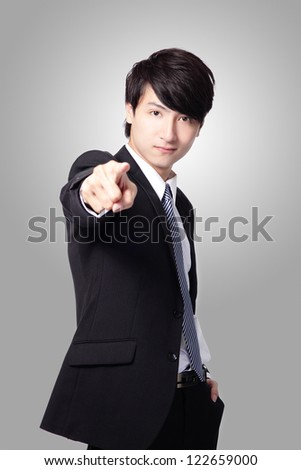 Happy asian man pointing fingers at you against white background Stock photo © deandrobot