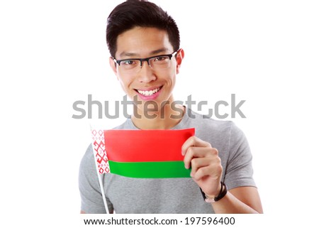 Happy young asian man holding flag of Belarus over white background Stock photo © deandrobot