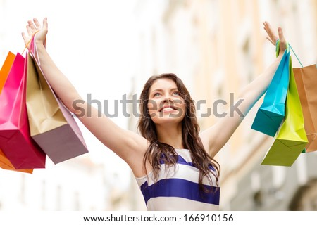 Beautiful woman with shopping bags in the ctiy Stock photo © vlad_star