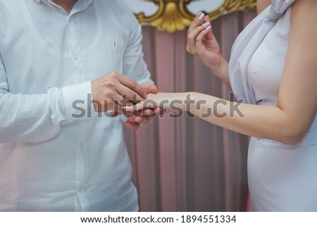 two happy girlfriends celebrating engagement with veil and champagne bottle stock photo © deandrobot
