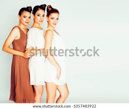 tree pretty stylish young woman with same hairstyle and makeup best friend together having fun lif stock photo © iordani