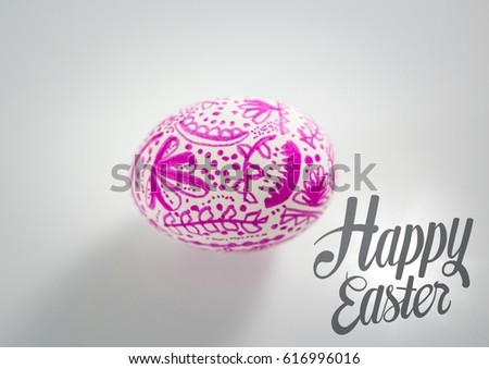 Grey easter graphic and pink patterned egg against white background Stock photo © wavebreak_media
