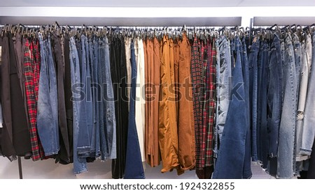 Closeup shot of clothes hang on a shelf in modern fashion store Stock photo © Nobilior