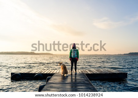 Hiking woman with backpack looking at inspirational autumn golde Stock photo © blasbike