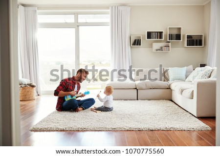 fathers day dad plays with children kids sitting on their fat stock photo © popaukropa