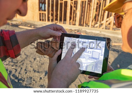 Male and Female Construction Workers Reviewing Kitchen on Comput Stock photo © feverpitch