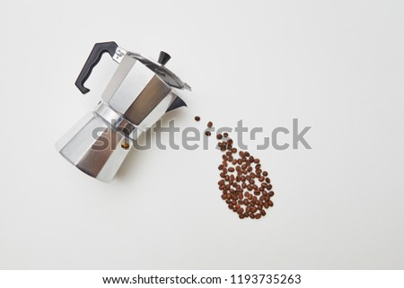 Coffee beans in the form of a drop dripping from a metal coffee  Stock photo © artjazz