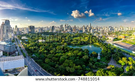 Landscape in Lumpini Park in Bangkok, Thailand. Lake, sunset background and modern skyscrapers in t stock photo © Ainat