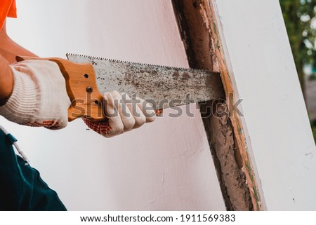 old vintage window renovation worker stripping paint stock photo © simazoran