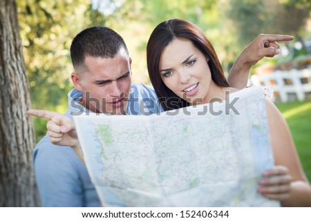 Young Lost and Confused Military Couple Looking at Map In Front  Stock photo © feverpitch