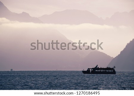 Boat on Swiss alke Luzern with mountain cliffs background silhou Stock photo © xbrchx