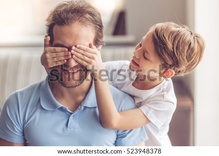 Cheerful father spending time with his little son at the park Stock photo © deandrobot