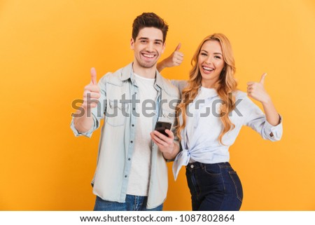 Image of joyous couple using smartphones together, isolated over Stock photo © deandrobot