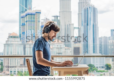 Young man teaches a foreign language or learns a foreign language on the Internet on her balcony aga Foto stock © galitskaya
