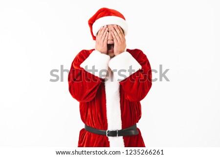 Portret bać człowiek 30s Święty mikołaj kostium Zdjęcia stock © deandrobot