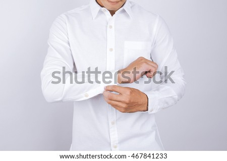 Cheerful adult office man wearing white shirt expressing success Stock photo © deandrobot