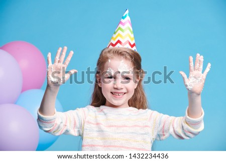 Cheerful little birthday girl showing her hands with white whipped cream Stock photo © pressmaster