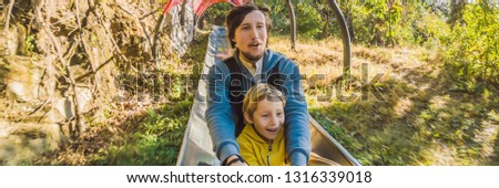 dad and son have fun on alpine roller coaster banner long format stock photo © galitskaya