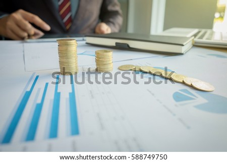 Close-up of coin, Businessman pointing to rising stack of coins Stock photo © Freedomz