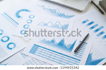 Businessman analysis on graph data paper with business colleague Stock photo © Freedomz