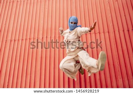 Fiatal aktív arab nő hidzsáb karate Stock fotó © pressmaster