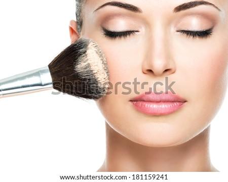 Closeup portrait of a woman applying dry cosmetic tonal foundati Stock photo © serdechny