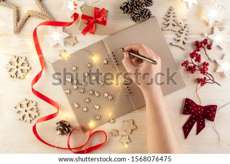 Overview of open notebook with blank pages surrounded by other supplies Stock photo © pressmaster