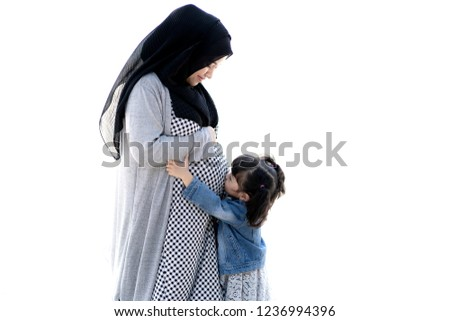 Young pregnant woman with her daughter isolated on white background Stock photo © Lopolo