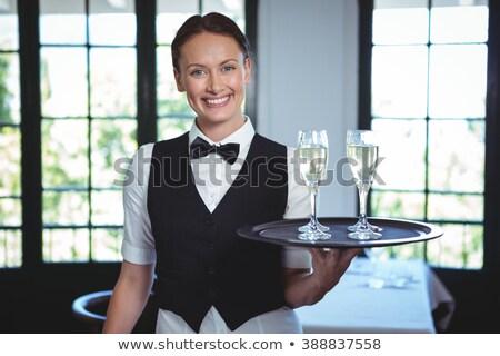 Retrato camarera champán gafas bandeja restaurante Foto stock © wavebreak_media