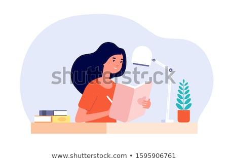 teenage student girl writing to diary or notebook stock photo © dolgachov