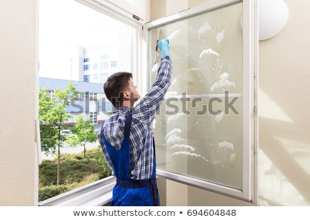 man cleaning window at home stock photo © lopolo