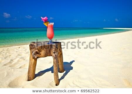 Vrouw oceaan strand zomer dranken Stockfoto © ElenaBatkova