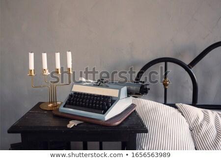 Retro candle holder and typewriter in bedroom Stock photo © dashapetrenko