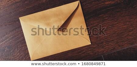 Golden vintage envelope on wooden background, newsletter and message Stock photo © Anneleven