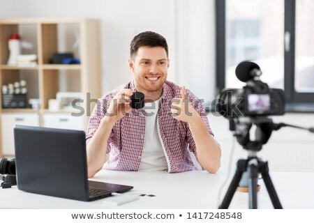 male blogger with smart speaker videoblogging Stock photo © dolgachov